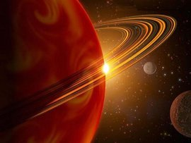 Астрономы озадачены красными дугами на спутнике Сатурна